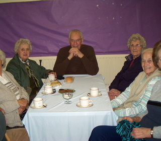 Church members and friends enjoying a coffee and a chat