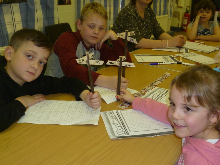 """One Direction"" holiday club - making sign posts to show the ""One"" direction to take"