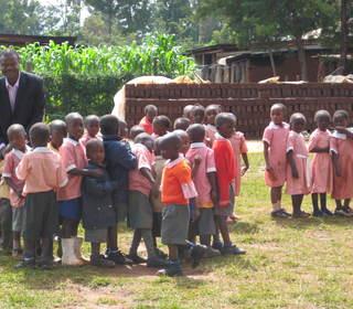 Dr Masibo Lumala and Upendo students