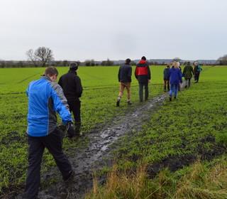 The diagonal across the farmer's field.