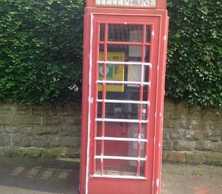 Telephone box before defibrillator installed.