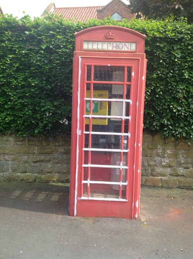 Telephone box before defibrillator installed.