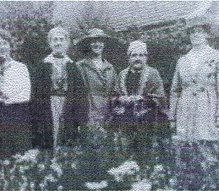 Miss Ethel Baggaley, Miss Miriam Dalby, ?, Mrs Mary Dalby, Mrs Caroline Elliot in the Dalbys' garden, in front of Fircroft