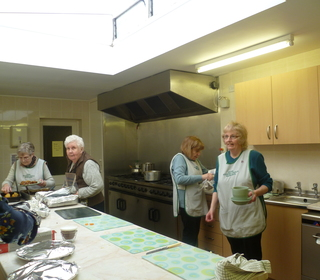 Busy kitchen team preparing Lunches