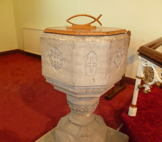 The font - the focus of many baptisms