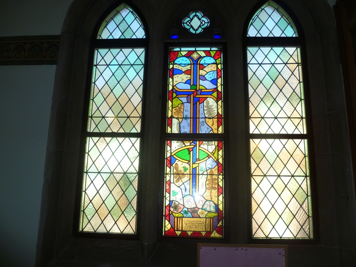 The stained glass window to commemorate out late minister - Revd Manchester