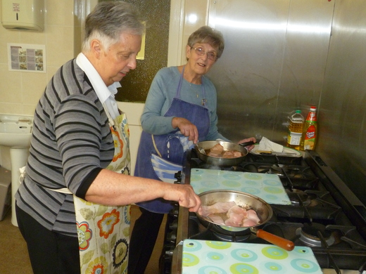 """Chris & Janet cooking the bacon for the """"Bacon Butties"""""""