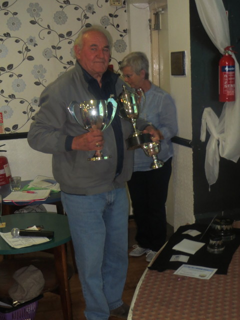 Mr Weedon with 3Trophies