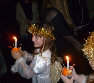 Angels joyously carry away their Christingles