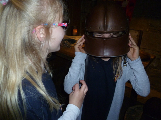 Felicity helps Chloe with the knight's helmet