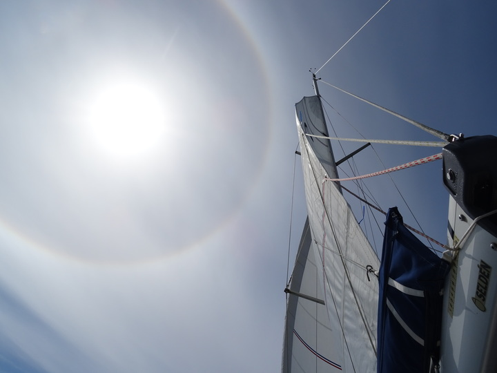 Sailing across Plymouth Sound, a halo around the Sun (a sign of the rapidly approaching low pressure system) was clearly seen. Taken from the deck of Liver Bird (Tanner)