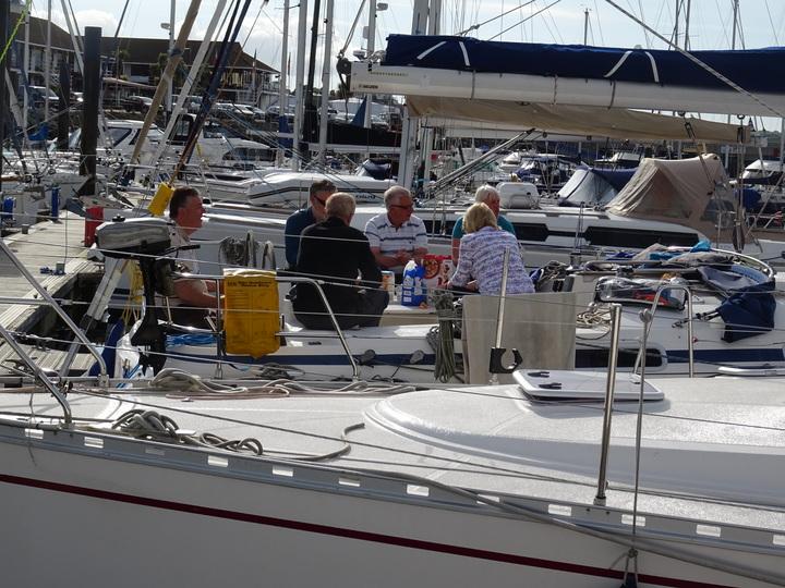 Breakfast at Berties - the crew enjoying their breakfast in Bertie's cockpit (Tanner)
