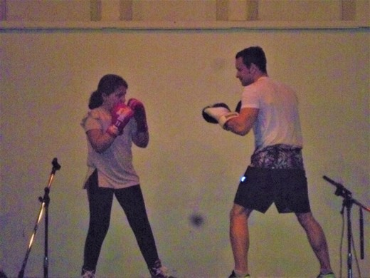 Tia demonstrates her boxing moves with Stuart