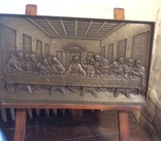"A bronze plaque depicting ""The Last Supper"""