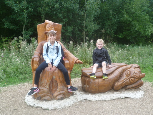 Chloe & Max take a well earned rest on the carved seats
