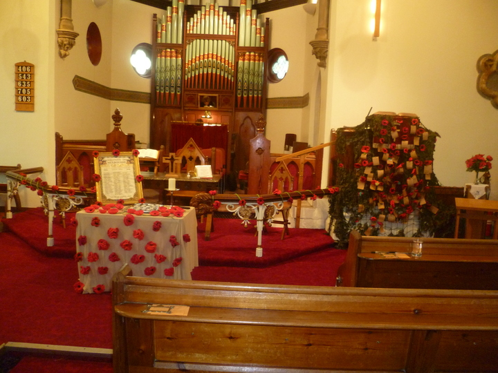 Poppies adorn the pulpit and the front of the Church