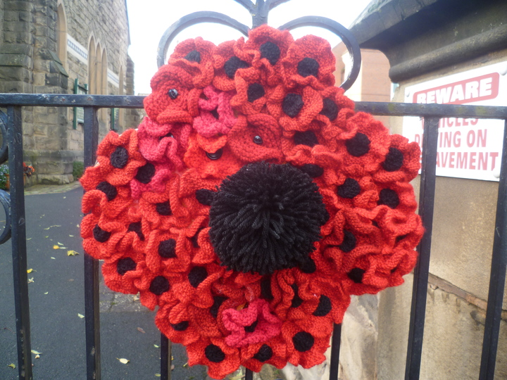 A Poppy wreath on the gate of the Church
