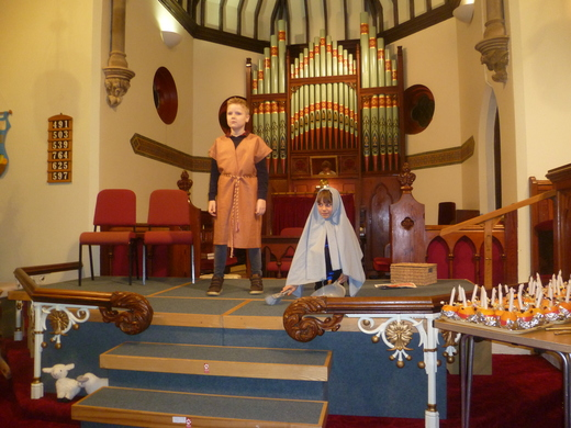 Mary and Joseph await the arrival of the postman