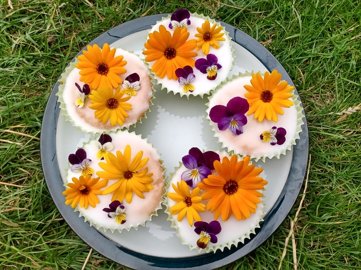 Five decorated fairy cakes, decorated with edible flowers, from Lucy (Long Eaton)